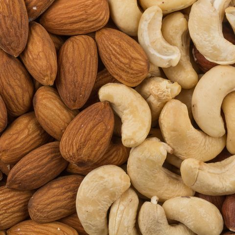 Mix of different nuts on background over close-up